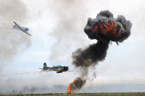 World War II Japanese airplanes fly near a fiery blast simulating explosions during the re-enacment of the bombing of Pearl Harbor at Saturday's Rocky Mountain Airshow at Rocky Mountain Metropolitan Airport.<br /> August 27, 2011<br /> staff photo/ David R. Jennings