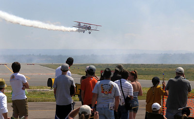 Gary Rower flies his Stearman airplane so the crowd can see during Saturday's Rocky Mountain Airshow at Rocky Mountain Metropolitan Airport. August 27, 2011 staff photo/ David R. Jennings