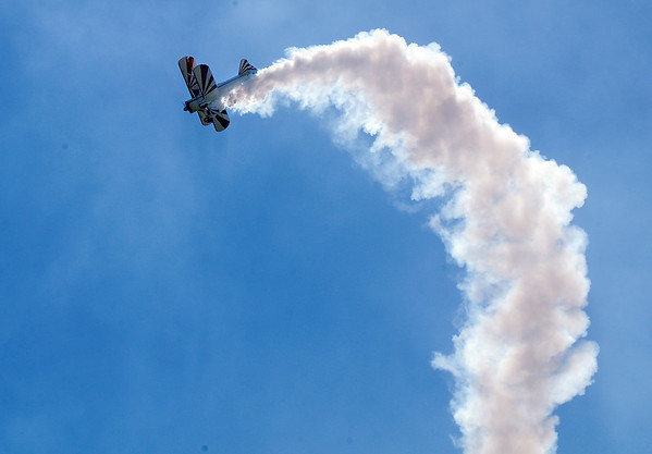 Gary Rower performs stunts in his Stearman airplane during Saturday's Rocky Mountain Airshow at Rocky Mountain Metropolitan Airport.<br /> August 27, 2011<br /> staff photo/ David R. Jennings