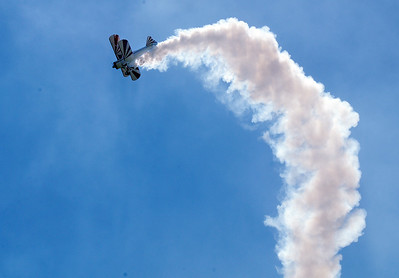 Gary Rower performs stunts in his Stearman airplane during Saturday's Rocky Mountain Airshow at Rocky Mountain Metropolitan Airport. August 27, 2011 staff photo/ David R. Jennings