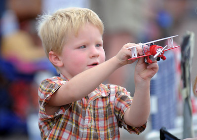 Lane Mook, 4, from Wiggins, plays with his toy airplane during Saturday's Rocky Mountain Airshow at Rocky Mountain Metropolitan Airport. August 27, 2011 staff photo/ David R. Jennings