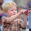 Lane Mook, 4, from Wiggins, plays with his toy airplane during Saturday's Rocky Mountain Airshow at Rocky Mountain Metropolitan Airport.<br /> August 27, 2011<br /> staff photo/ David R. Jennings