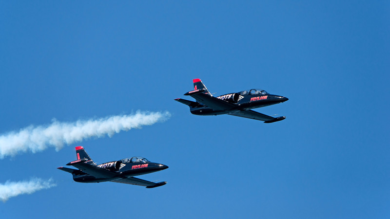 The patriots fly with 2 pilots in the cockpit (unlike the Blue Angels who fly with one).