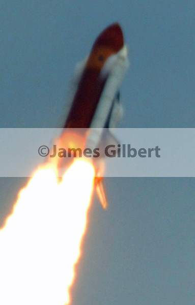 Near Max-Q... with the Prandtl-Glauert vapor cones visible on both Boosters & behind the nose of the orbiter.