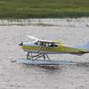 Sealane 182 C-GZFM floatplane taxiing on the Moose River at Moosonee.