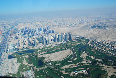 Golf course in the foreground (Emirates or the Lakes?)
