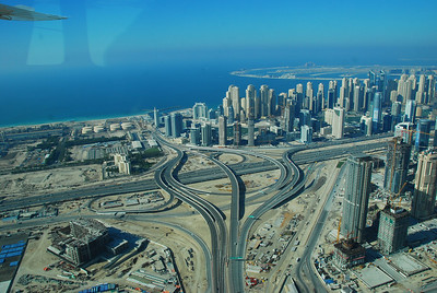 Jumeirah Beach Residences with Palm Jumeirah in the distance.