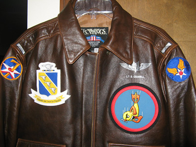 This is the front of a reproduction jacket that the back was painted the same as her Dad's except I added the arm, bomb group and bomb squadron patches.
