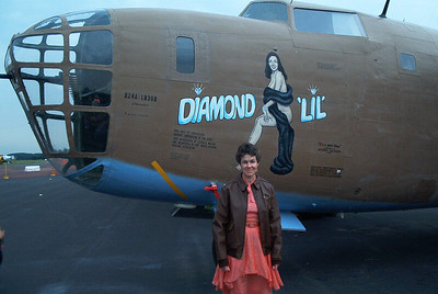 Sharon wearing her Dad's A-2 at Reading Air Show prior to the Hanger dance. Sharon has on a vintage 1930's dress.