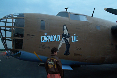 """Sharon wearing her Dad's jacket at the Raading Air show 2004 in front of the B-24 """"Diamond Lil"""""""