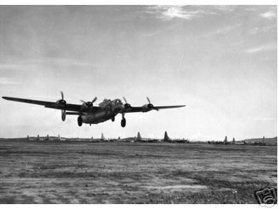 This  a B-24 landing or taking off somewhere in the South Pacific  theatre. It is not his plane.