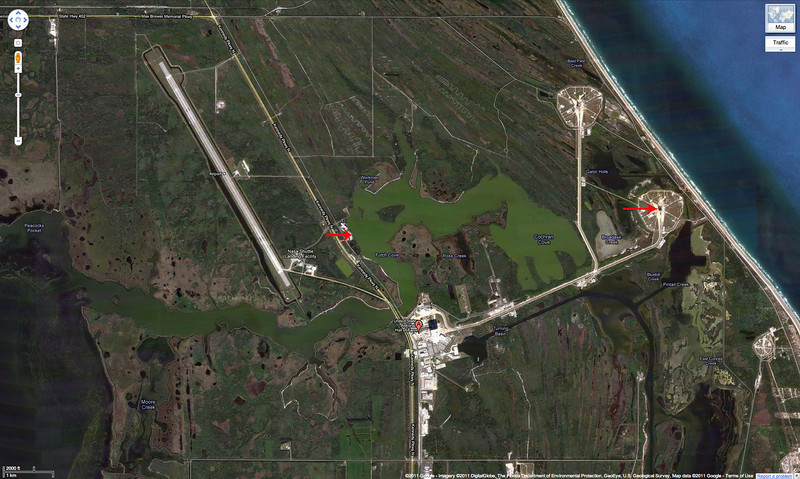 This map shows roughly where Brian and I were in relation to the launch pad, which is about 3 1/2 miles or so from us.  We were at the point of the red arrow on the left, and the launch pad is at the tip of the red arrow on the right.  That big blue thing on the right side is the Atlantic Ocean.
