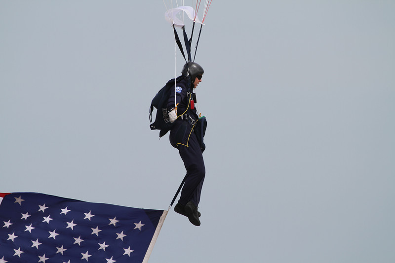 A Wings of Blue jumper with the American flag in trail to start the show