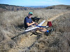 Here's Kent assemblying his scratch-built soarer on the summit of Sobranie Point.