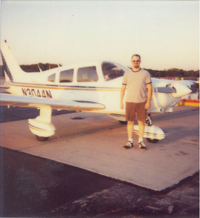 This is the Polaroid my instructor took of me right after my very first solo.  The place: KUNU - Dodge County Airport in Juneau, Wisconsin.  The aircraft: Piper Warrior N3044N, the place I did most of my instruction in.