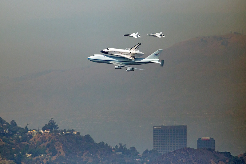 Space Shuttle Endeavour flying over the NBCUniversal building.