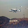Space Shuttle Endeavour flying over the Hollywood sign on top of a 747 with two F-18 escorts.