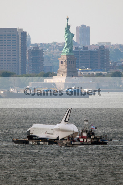 Space Shuttle Enterprise passes by Lady Liberty.