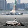 Space Shuttle Enterprise passes by Lady Liberty.