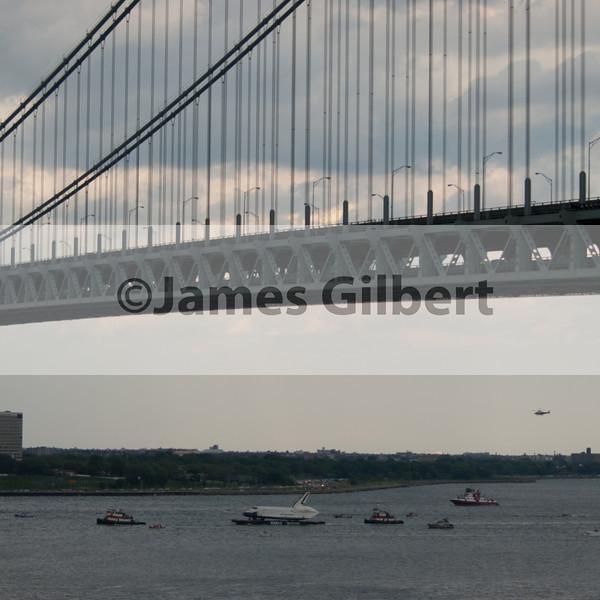 Space Shuttle Enterprise passes under the Narrows Bridge.