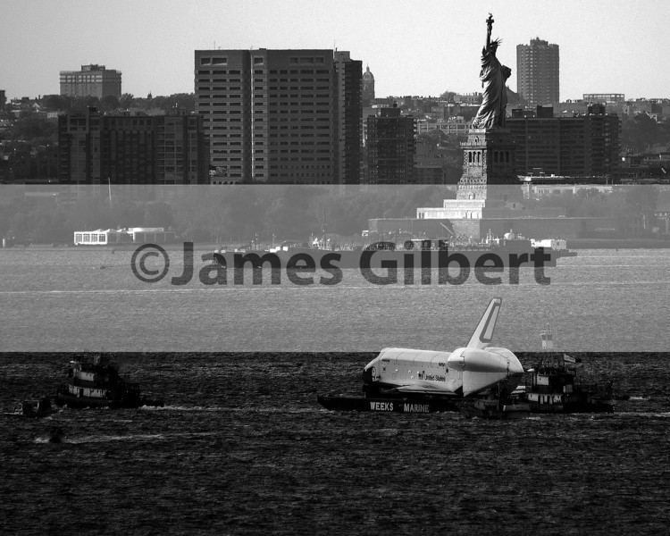 The Enterprise passes by the Statue of Liberty on its way to the USS Intrepid.