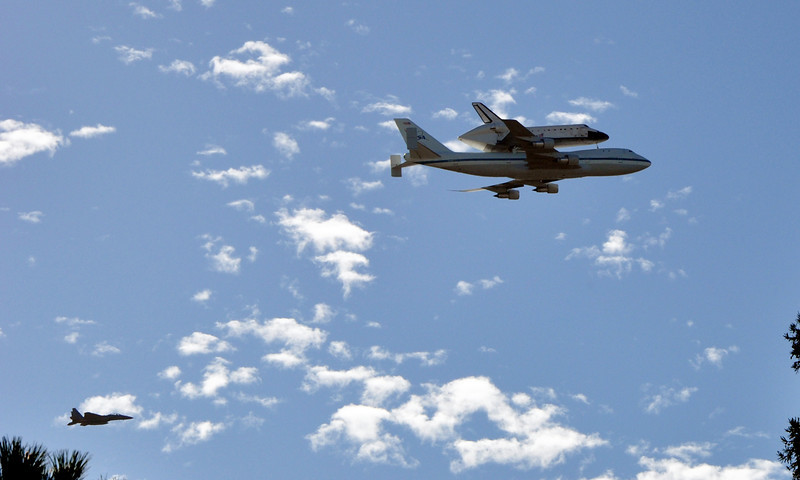 Space Shuttle Endeavor, with the chase plane in the lower left.