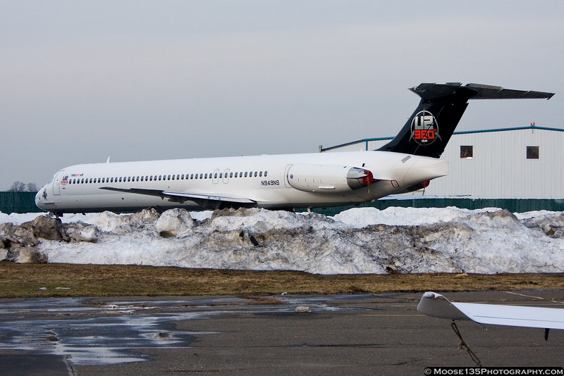 USA Jet Airlines MD-83, carrying the Boston Bruins for an NHL game with the New York Islanders.  Aircraft carries a special paint scheme used duing the U2 band tour.