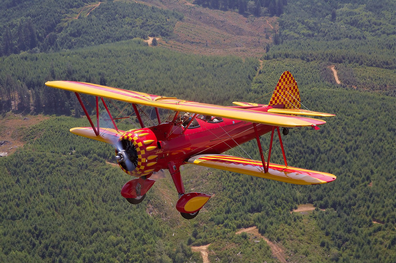 """Stearman N56772, """"Tillie"""", in flight over Oregon."""