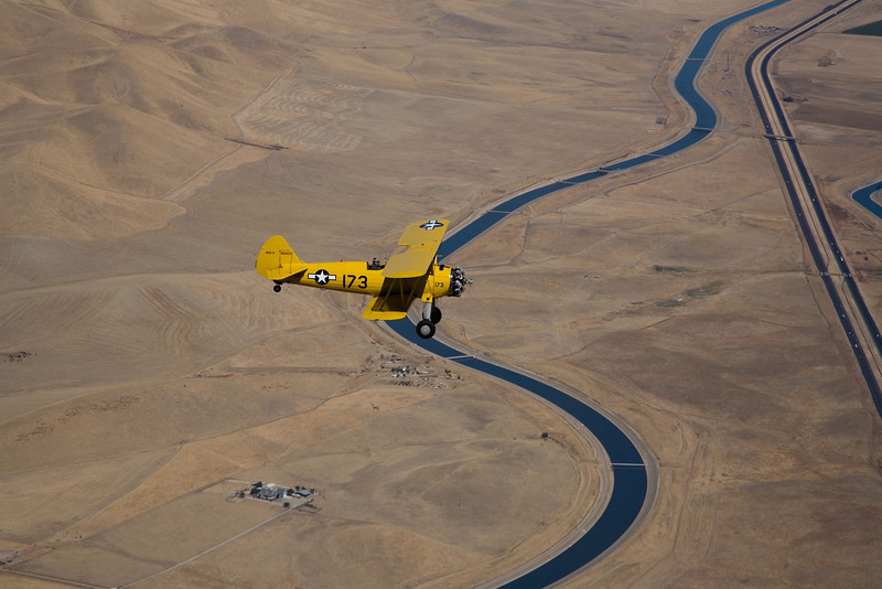 Stearman N54173 over the California Aqueduct.