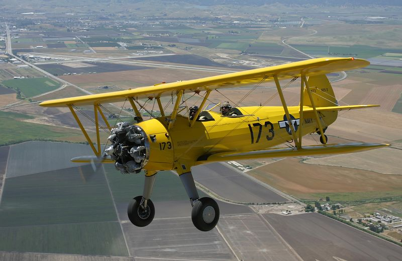 Stearman N54173 in flight with Hollister Muni (3O7) in the background.