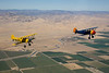 Stearman N54173 (yellow) and Stearman N7740C (blue) over the California Aqueduct