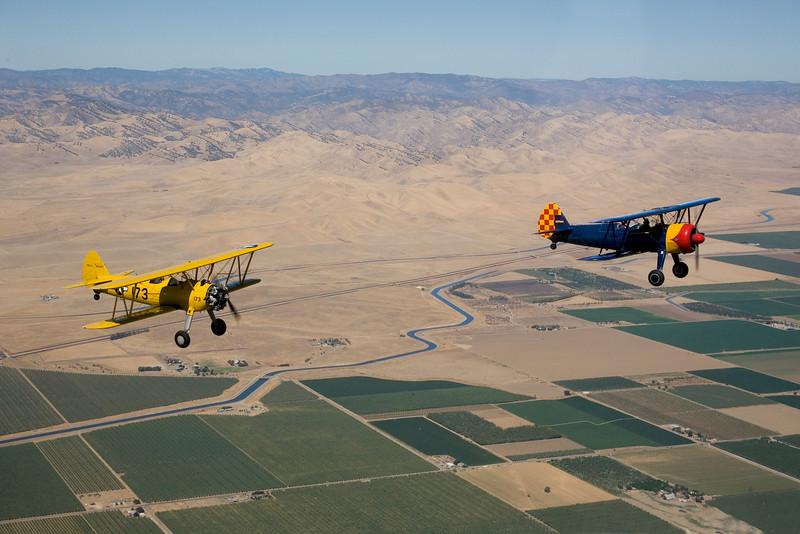 Stearman N54173 (yellow) and Stearman N7740C (blue) over the California Aqueduct