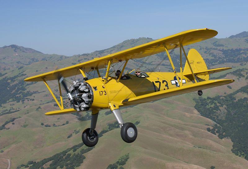 Stearman N54173 flying near the hills northeast of Hollister California.