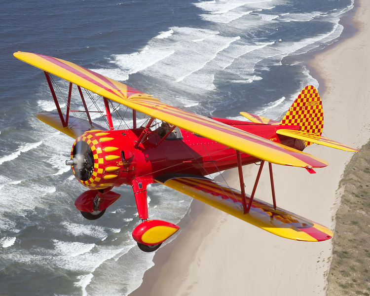 Strearman over the beach in Oregon.