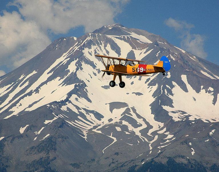 Stearman N56914 flying near Mount Shasta in Northern California.