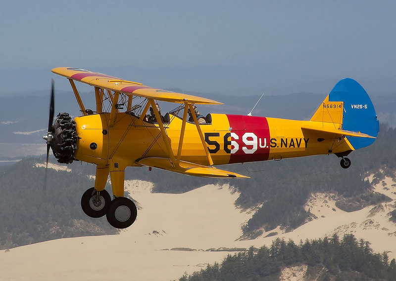 Stearman N56914 flying over an Oregon beach.