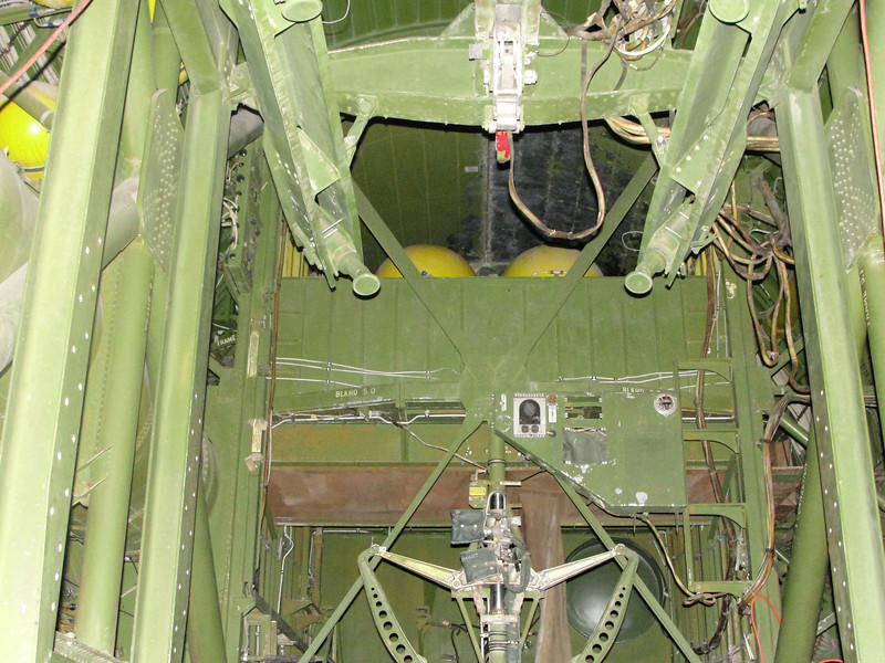 Inside the forward bomb bay, looking forward.  The yoke mechanism at the bottom center is the operating bellcrank for the bomb bay doors.