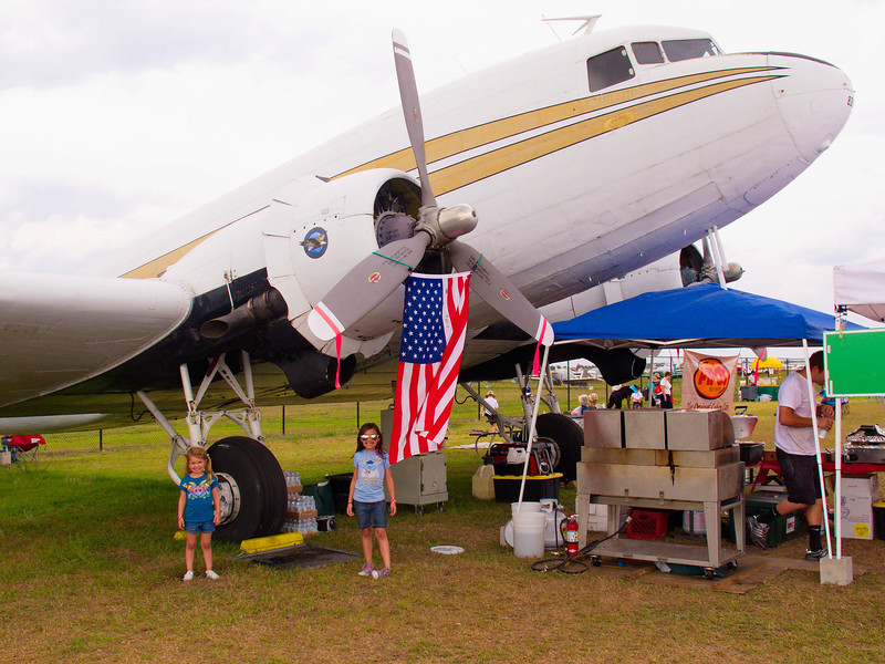 Laney and Ella stand by a C-47/DC-3, the kind their great-great grandma Toots made during WWII