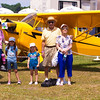 Standing by a J-3 Cub like Pop used to fly