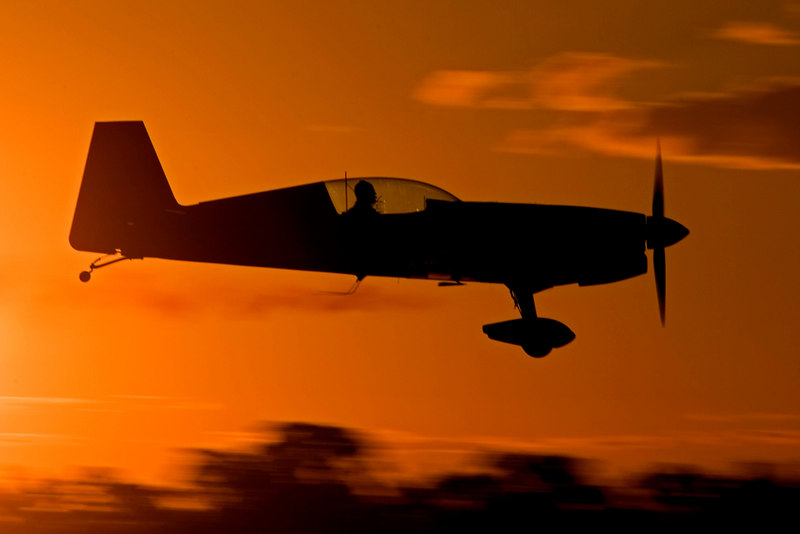 Tom Moon at low level in his Extra 300 as the sun sets at Temora.<br /> <br /> Tom was killed at Temora on January 20, 2009 while flying his Extra. Our sincere condolences to his family and friends.