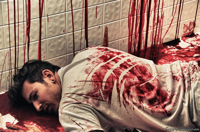 Man on a bloody floor