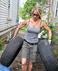 Nicole Curtis, licensed realtor, interior designer and host of DIY Network/HGTV's original series Rehab Addict on location at her 4th Street project in North Minneapolis. Nicole is bringing old tires left on the property to the front yard for recycling. Nicole strives to limit the amount of trash she has on her projects and reuses or recycles as much as she can.