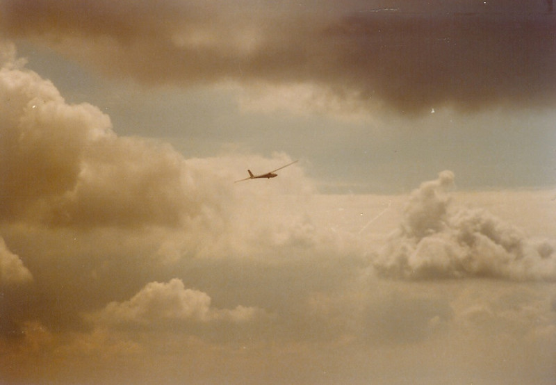 Early 1980s - Soaring Society of Boulder's Schweitzer 1-34, N134BC flying in the clouds.