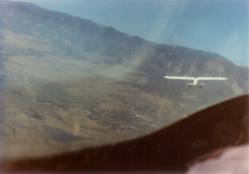 Photo taken from back seat of the 2-32 on tow over Boulder, CO.  Bill Jr. flying the 2-32 and Bill Sr. towing in Piper PA-18/180 Super Cub - N4785F.