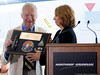 Ms. Pat McMahon, Northrop-Grumman VP presents a commemorative plaque to Bob Smyth, Grumman test pilot and first pilot to fly the F-14 in December 1970.