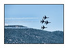 The USAF F-16 Thunderbirds flying near the USAF Academy during the 2009 graduation performance.