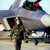 US Air Force Master Sergeant Joseph Chew, F-22 dedicated Crew Chief, walks ahead of his F-22 Raptor as it's towed for an early morning test flight on March 1st, 1999, at the F-22 Combined Test Force Facility, Edwards Air Force Base, California.