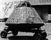 Apollo 13 in front of Hanger 5 at Hickam AFB Hawaii.  Taken in April 1970.  Signed by James Lovell February 25, 1996.  Photo by Gene Pardee