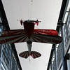 Inside the main entrance.  A Pitts Special, upside down, hanging from the ceiling, as if in the top of a loop.