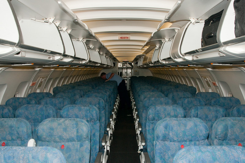 The interior of a US Airways (former America West) A319 at Phoenix. Note the America West logos still on the seats.